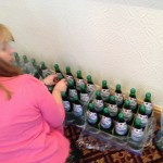 Susan adding our logo labels to the water