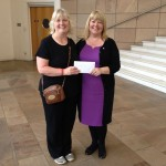 Lynne receiving a lovely cheque from Jacqui